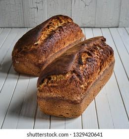 Chia seed sourdough sandwich bread on a wooden table board