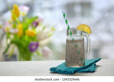 Chia seeds in glass of water on table