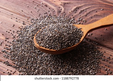 chia seeds on a wooden background. Useful supplements, super food, healthy food, veggie