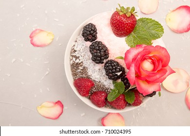 Chia seeds pudding with berries. Dessert with chia, raspberry, blueberry, strawberry and whipped cream. Healthy super food detox concept.