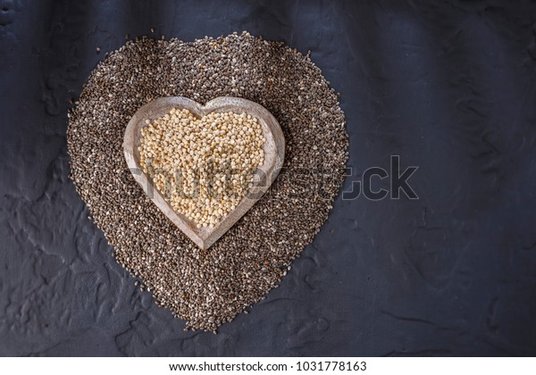 Chia seeds and quinoa on black background