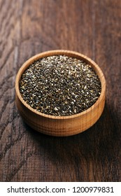 Chia seeds in a wooden bowl, closeup