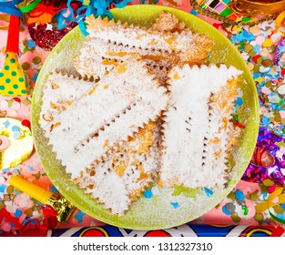 Chiacchiere or Cenci, typical Italian dessert for carnival. They are fried and covered with powdered sugar.