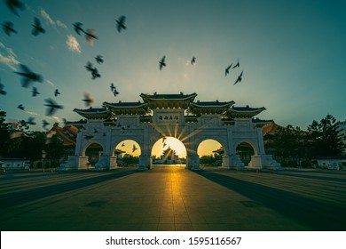 """Chiang Kai Shek Memorial Hall with doves flying and the top building is written """"Chiang Kai Shek Memorial Hall"""" in Chinese"""