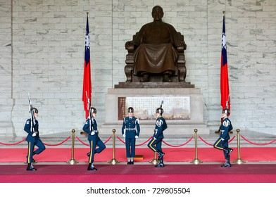 Chiang Kai-Shek Memorial Hall, Taipei, Taiwan - May 7, 2017 : The changing of the guards ceremony against the statue of Chiang Kai-Shek in memorial hall. This place is a popular travel destination.