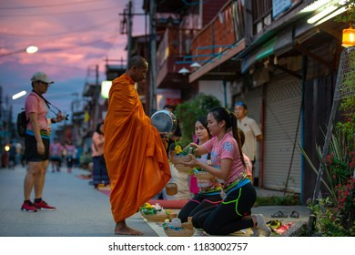 Chiang Khan district, Thailand -September 02, 2018 : Buddhist to offer food to the monks, to do good thing according to our religious belief and receive blessing from the monk.