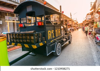 Chiang Khan, Loei Province/ Thailand -  Oct 12 2018 : Car modified to look like a steam train free services for tourists at walking street Chiang Khan, Loei Province, Thailand.