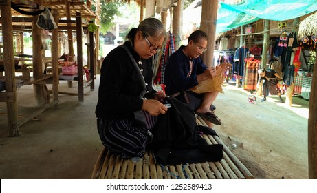 CHIANG KHAN, LOEI, THAILAND - Circa August,2018 :Peoples in Tai Dum traditional dress are making souvenirs  at Tai Dam Cultural Village in Chiang Khan, Loei Province.