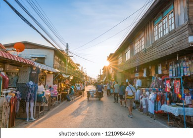Chiang Khan,Loei province/Thailand - Oct 12 2018  :  Tourists walking and shopping at Chiang Khan  walking street in sunset ,Thailand's famous tourist destination.