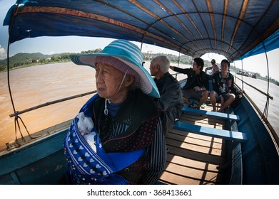 Chiang Khong, Thailand - 1 February 2014: The boat crosses the border between the Thai city of Chiang Khong and Huai Hai Lao. In the boat, tourists and locals