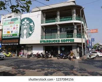 CHIANG MAI, THAILAND—MARCH 2018: Façade of Starbucks Coffee with motorcycles parked outside at the Old City of Chiang Mai.