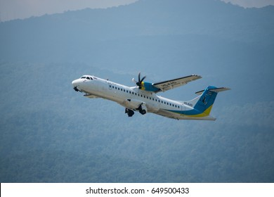 Chiang Mai , Bangkok - October 19, 2016 ; ATR72-500 of Kan Air registered HS-KAD as seen take off from Chiang Mai International Airport with mountains background.