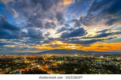 Chiang Mai cityscape at twilight from a high angle with light of building and Doi Suthep as a background