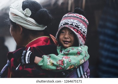 """Chiang Mai Province, Thailand.November19,2018: Little Hill Tribe Girl With Her Smiling Face, At Doi Ang Khang """"Baan Nor Lae Village"""" Northern Thailand. (Dramatic Tone)"""