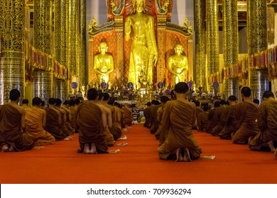 CHIANG MAI, THAILAND - 1/18/2016: Monks praying at Wat Chedi Luang temple in Chiang Mai, Thailand.