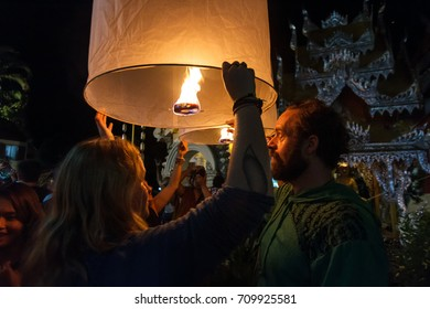 CHIANG MAI, THAILAND - 12/30/2015: Tourists release floating lanterns at a Buddhist temple on New Year's Eve in Chiang Mai, Thailand.