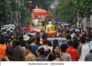 Chiang Mai / Thailand - 13 April 2013: Songkran Festival is Thai's New Year. There are a procession of Buddha from different temple at Thapae Road, Chiang Mai. Peple celebrate this with scented water.