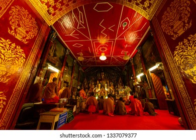 Chiang Mai, Thailand - 14 Jan 2015: Buddhist monks pray in Wat Phrathat Doi Suthep Temple. The temple founded in 1385 is a major tourist attraction in Chiang Mai.