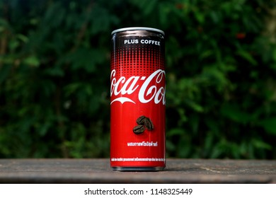 Chiang Mai, Thailand. – 2 Aug 2018 : Coca-Cola Coffee Plus on green leaf background.
