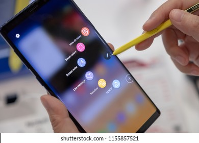 CHIANG MAI, THAILAND - 2018 AUG 10 : Woman using Samsung Galaxy Note 9 with new yellow S Pen,  The new Samsung Galaxy Note 9 is seen during a product launch.