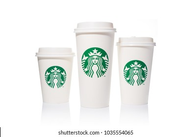 Chiang Mai, Thailand - 24 February 2018 - Starbucks coffee paper cups in 3 sizes, Tall, Grande, and Venti, are placed side by side on white background on February 24, 2018 in Chiang Mai, Thailand