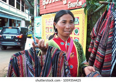 CHIANG MAI THAILAND - 30 January 2018: local woman from Mhong mountain tribe that locate close to Thailand and Myanmar border sell the hand made t-shirt at Doi Ang Khang, Chiang Mai, Thailand