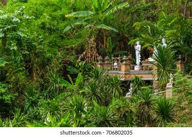 CHIANG MAI, THAILAND - 5/14/2015: Green jungle surrounds the Wat Pha Lat temple on Doi Suthep mountain.