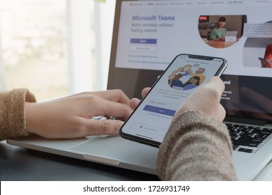 CHIANG MAI, THAILAND - APR 11, 2020 : A working from home employee is downloading the Microsoft Teams social platform, ready for remote working in isolation from home