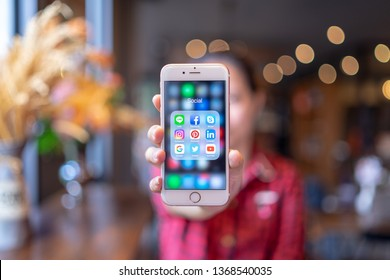 CHIANG MAI, THAILAND - Apr.08,2019: Woman holding Apple iPhone 6S Rose Gold with icons of social media on screen. Social media are most popular tool. Smartphone lifestyle. Starting social media app.