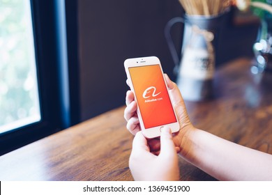 CHIANG MAI, THAILAND - Apr.08,2019: Woman holding Apple iPhone 6S Rose Gold with alibaba apps.Alibaba is the the world's biggest online commerce company. Its three main sites Taobao,Tmall and Alibaba.