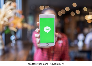 CHIANG MAI, THAILAND - Apr.08,2019: Woman holding Apple iPhone 6S Rose Gold with LINE apps on screen. LINE is a new communication app which allows you to make free voice calls and send free messages.