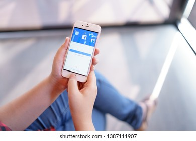 CHIANG MAI, THAILAND - Apr.08,2019: Woman holding Apple iPhone 6S Rose Gold with facebook app on the screen. Facebook is a popular free social  media are used for information sharing and networking