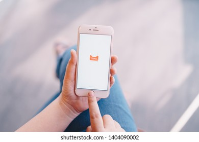 CHIANG MAI, THAILAND - Apr.08,2019: Woman holding Apple iPhone 6S with alibaba apps on screen.Alibaba is the the world is biggest online commerce company.Its three main sites Taobao,Tmall and Alibaba.