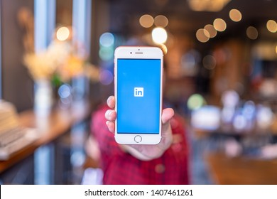 CHIANG MAI, THAILAND - Apr.08,2019: Woman holding Apple iPhone 6S Rose Gold with Linkedin application on the screen. Linkedin is a business and employment oriented social networking service.