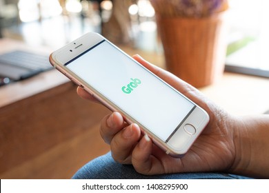 CHIANG MAI, THAILAND - Apr.27,2019: Woman holding Apple iPhone 6S Rose Gold with  Grab apps on screen. Grab is smartphone app all-in-one transport booking in South-East Asia.