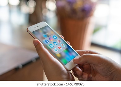 CHIANG MAI, THAILAND - Apr.27,2019: Woman holding Apple iPhone 6S Rose Gold with icons of social media on screen. Social media are most popular tool. Smartphone lifestyle. Starting social media app.