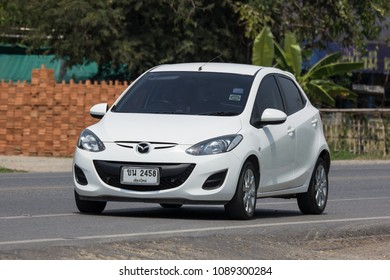 CHIANG MAI, THAILAND - APRIL 20 2018: Private Eco car Mazda 2. On road no.1001 8 km from Chiangmai Business Area.