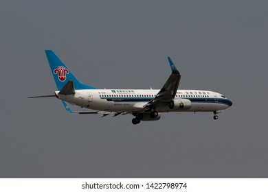 Chiang Mai, Thailand. April 20, 2019. China Southern Airlines Boeing 737-800 Reg. B-1520 with Mona lisa Image on Engine on Short Final Approach for Landing at Chiang Mai International Airport.