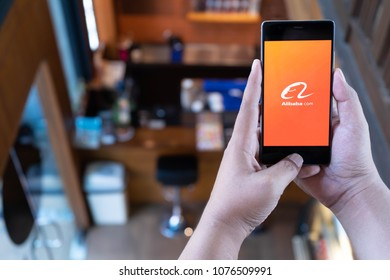 CHIANG MAI, THAILAND - April 21,2018: Man hands holding HUAWEI with alibaba apps on screen. Alibaba's the the world's biggest online commerce company. Its three main sites Taobao,Tmall and Alibaba.