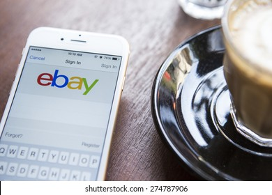 CHIANG MAI, THAILAND - APRIL 22, 2015: Close up of ebay app on a Apple iPhone 6 screen. ebay is one of the largest online auction and shopping websites.