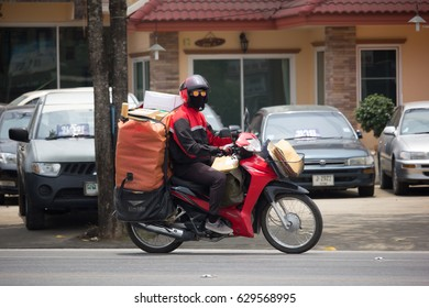 CHIANG MAI, THAILAND -APRIL 23 2017: Postman and Motercycle of Thailand Post. Photo at road no.121 about 8 km from downtown Chiangmai, thailand.