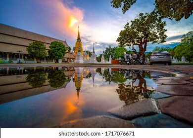 CHIANG MAI, THAILAND - APRIL 28, 2020 : Wat Suan Dok Temple reflection in twilight, is a Buddhist temple and Royal Temple of the Third Class in Chiang Mai Thailand. Landmark of Chiang mai.