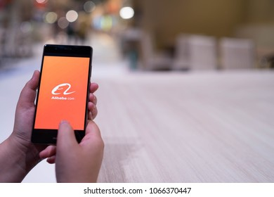 CHIANG MAI, THAILAND - April 4,2018: Woman hands holding HUAWEI with alibaba apps on screen. Alibaba's the the world's biggest online commerce company. It's three main sites Taobao,Tmall and Alibaba.
