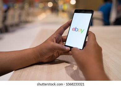 CHIANG MAI, THAILAND - April 4,2018: Man hands holding HUAWEI with eBay apps on the screen. eBay is one of the most popular ways to buy and sell goods and services on the internet.