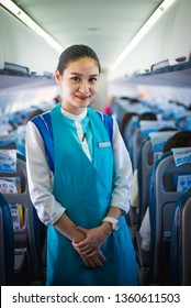 Chiang Mai / Thailand - April 5 2019: Flight attendants smiling aboard aircraft