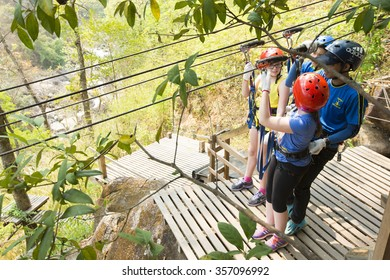 CHIANG MAI, THAILAND -APRIL 6: Tourists are preparing on a zip line base, An activity in a hill on April 6,2014. It is one of signature of Chiang Mai.