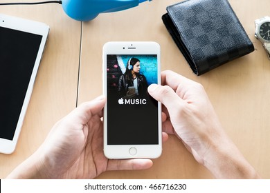 CHIANG MAI, THAILAND - Aug 08,2016: Hand of man holding a Apple iPhone with Music app showing on screen. Apple Music is the new iTunes-based music streaming service that arrived on iPhone.