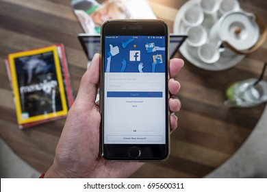 CHIANG MAI, THAILAND - AUG 14, 2017: A man holds Apple iPhone 6S with facebook application on the screen.facebook is a photo-sharing app for smartphones.