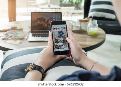 CHIANG MAI, THAILAND - AUG 15, 2017: A woman hand holding iphone with story and search page of instagram application. Instagram is largest and most popular photograph social networking.