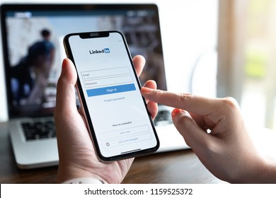 CHIANG MAI, THAILAND - AUG 18, 2018:  A women holds Apple iPhone X with LinkedIn application on the screen.LinkedIn is a photo-sharing app for smartphones.